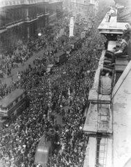 Crowds celebrating V E Day  Whitehall  London  8 May 1945.