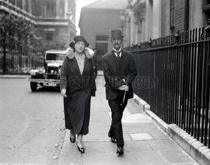 Mr and Mrs Chamberlain arriving at Downing Street  19 September 1931.