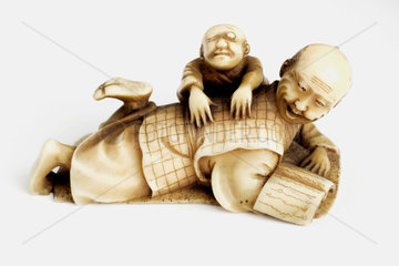 Netsuke of a man being massaged  Japanese  18th or 19th century.