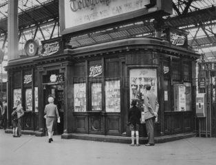 Boots kiosk  Waterloo Station  London  c 1950s.