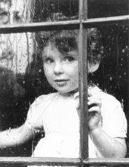 Boy looking through window  November 1949.