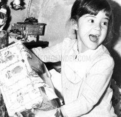 Katie Fisher opening a Christmas present  Cheshire  December 1984.