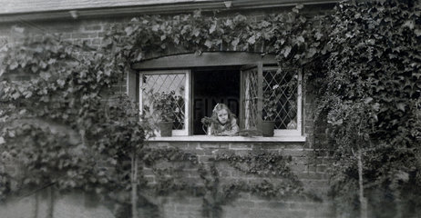 Girl at a garden window  mid-late 19th century.