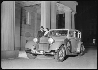 A man and woman with a Mercedes Benz motor car  c 1934.