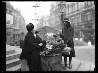 Flower seller in Piccadilly Circus  1932.