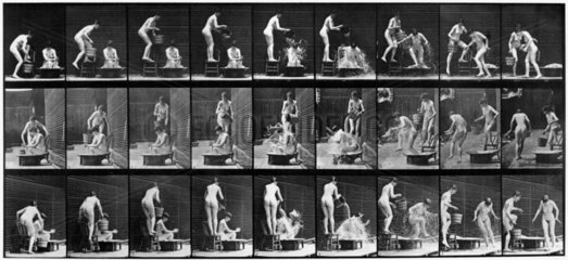 Nude woman pouring water over another nude woman in bath  c 1870s.