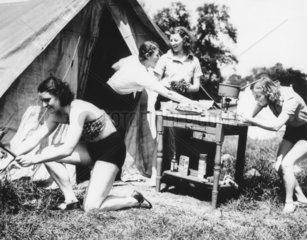 Four women outside a tent during their camping holiday  c 1930s.