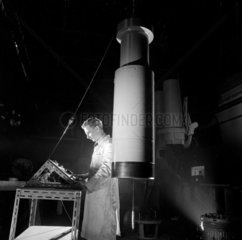 A worker with a flat scanning unit  Grubb Parsons telescopes  Heaton   1962.