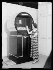 Woman demonstrating a futuristic radio set  Radiolympia  London  1933.