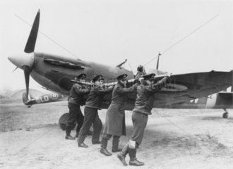 Airmen wheeling out a Spitfire  26 February 1942.