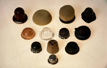 Range of contraceptive cervical caps  20th century.