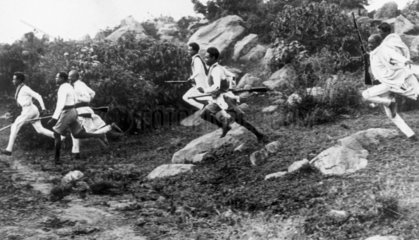 Young Abyssinian warriors running to reach cover  24th October 1938.