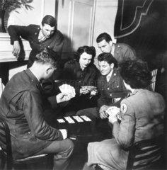 Soldiers and welfare girls playing cards  World War Two  1942.