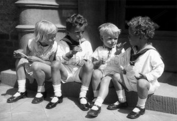 Children eating ice-lollies  c 1930s.
