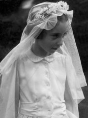 Walter Nurnberg's daughter aged about 7 years in communion dress  C1957.