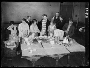 Miners' families preparing strike hampers at Bedwas  Wales  1936.