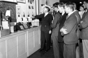 Mr Groom demonstrating smoke abatement  Science Museum  1936.