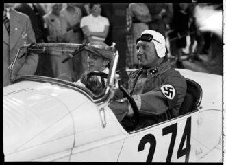 A swastika-wearing driver of a motor racing car  c 1934.