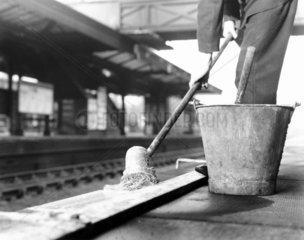 Whitewashing the platform edges at the Lond
