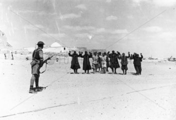 An Italian garrison surrendering to their Australian conquerors  17 May 1941.