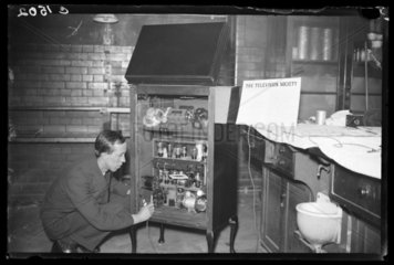 Man attending to a television receiver  1933.