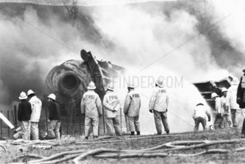 Firefighters cooling a petrol tanker  Moore  Cheshire  1983.