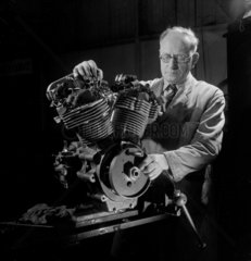 An engineer times valve ignitions on a new JA Prestwick racing motor  1953.
