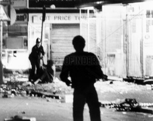Police officer apprehending a rioter  Brixton  London  12 April 1981.