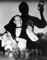 Waiter cleaning glasses  1940s.