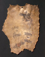 Human skin  tattooed with flowers and inscriptions  French  1850-1900.