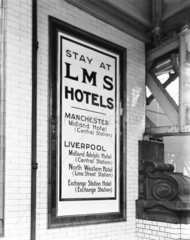LMS poster at Manchester Victoria Station  1925.