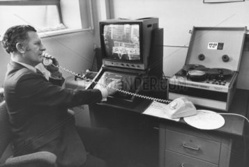 Security officer watching closed-circuit TV in a supermarket  January 1975.