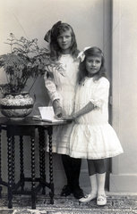 Two girls in white dresses  c 1900s.