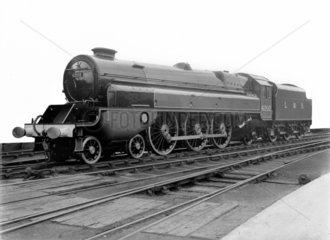 Forward turbine side view of LMS steam turbine locomotive  No. 6202  4-6-2.