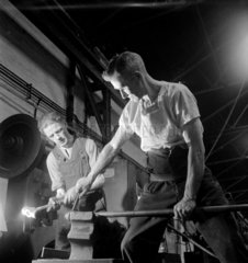 Two foundry workers seal a steel tube at the Talbot Stead works  Walsall.
