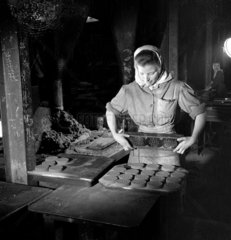 A young woman in iron foundry  Lloyds  Burton  1953.