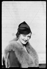 Woman displaying the latest hat fashion  1933.