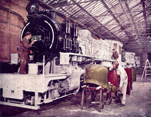 2-8-0 steam locomotive being painted for East African Railways.