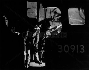 Driver and fireman on the footplate of steam locomotive  c 1957.