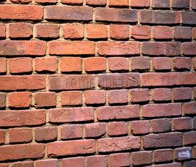 A brick wall  late 20th century.