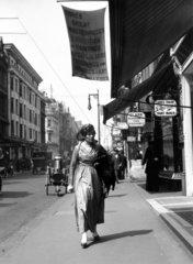 Woman wearing the latest fashions walking a