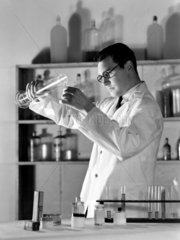 Chemist working in a laboratory  1949.
