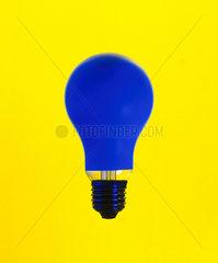 Blue lightbulb on yellow background.