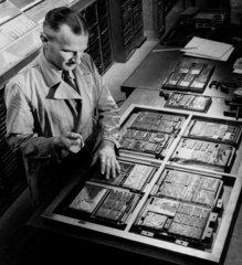 A printer makes up letterpress blocks in frames Sellar and Sellar  Reading  1955.