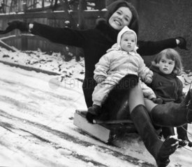 Diana Rigg sledging with her nieces  Christmas 1964.