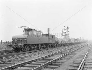 Electric locomotive with a goods train at Aintree  1912