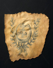 Human skin tattooed with wreathed crescent  probably French  19th century.