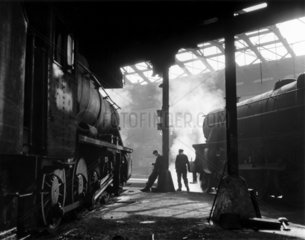 Grimy 8F and Class 5 steam locomotives.