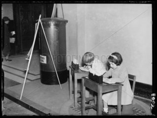 Children writing to Father Christmas  1934.