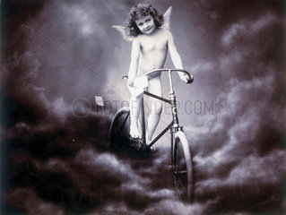 Nude girl posing as a cherub.
